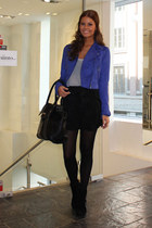 blue jacket - black shorts