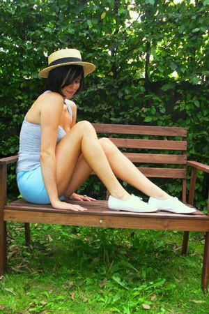 blue top - blue shorts - white shoes - yellow hat