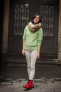 Red-boots-lime-green-sweater-off-white-pants