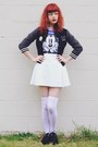Black-varsity-thrifted-jacket-white-thrifted-skirt
