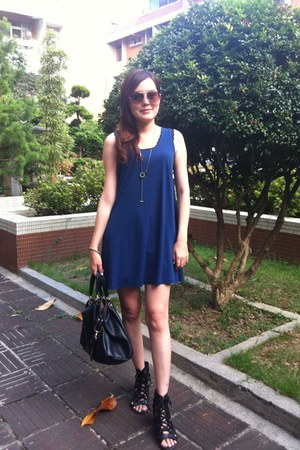 black bag - navy dress - brown sunglasses - charcoal gray cross necklace