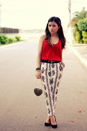 black bag - ruby red shirt - white pants