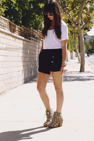 black asymmetrical shorts - camel leopard boots - white t-shirt