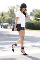black embossed bag - black leather shorts - black ankle strap heels