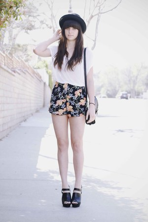black hat - white brandy melville shirt - orange Insight shorts