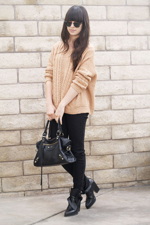 camel cable knit sweater - black ankle strap boots - black snake print pants