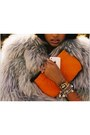 Fox-fur-shag-jacket-louis-vuitton-bag-white-gold-cartier-bracelet