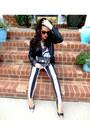 Black-striped-bebe-jeans-black-faux-leather-mural-jacket