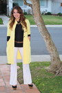 Yellow-kikapaprika-coat-black-kikapaprika-top-white-kikapaprika-pants
