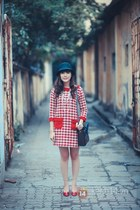 red dress - forest green hat - black bag