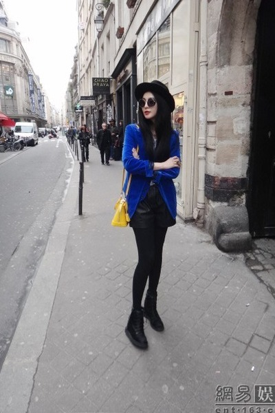 black boots - blue blazer - black tights - yellow bag - black shorts