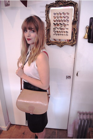 tan satchel unknown bag