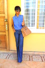 Blue-denim-flared-jeans-denim-studded-collar-shirt-mustard-bag