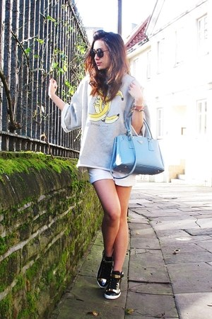 black round sunglasses - sky blue saffiano Prada bag - white Zara shorts