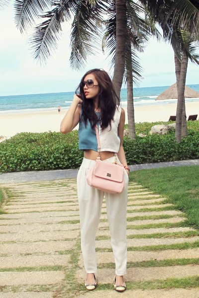 light pink Dolce & Gabbana bag - black Victoria Beckham sunglasses