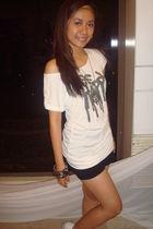 black shorts - white shirt