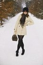 Beige-terranova-coat-black-faux-fur-new-yorker-hat-black-tights-louis-vuit