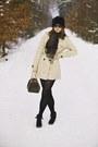 Beige-terranova-coat-black-faux-fur-new-yorker-hat-black-tights-louis-vuit