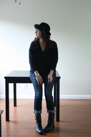 black fedora hat - black motorcycle boots - navy jeans - black studs cardigan