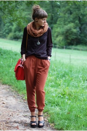burnt orange H&M pants - black H&M shirt - red H&M bag - gold delamopl necklace