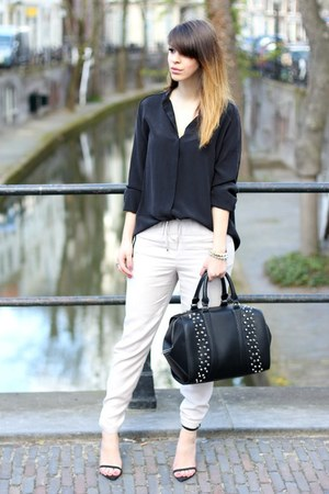 black studded Zara bag - off white H&M Trend pants - black silk COS top