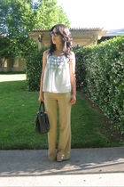 blue xhilaratioin top - beige American Eagle pants - brown Steve Madden purse -