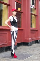 white striped New Yorker jeans - red Tommy Hilfiger hat - black H&M vest