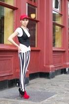 white striped New Yorker jeans - red Tommy Hilfiger hat - black H&M vest
