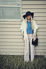 Black-hat-black-purse-off-white-cape-sky-blue-blouse