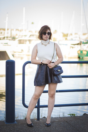 white textured H&M top - gold lion Ebay necklace - black leatherette H&M skirt