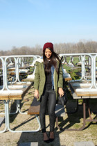 army green parka Zara coat - brick red oxblood beanie Zara hat