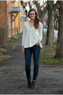 Heather-gray-angelo-carutti-boots-navy-skinny-house-jeans