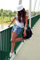 light blue Cubus shorts - white New Yorker Yankees hat - black Mizensa bag