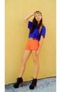 Black-shoes-carrot-orange-shorts-blue-top-orange-accessories-gold-belt
