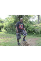 black logo on front Coogi shirt - red Blues shorts - black black socks socks