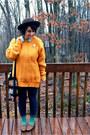 Brown-target-hat-mustard-oversized-thrifted-sweater-light-blue-target-shirt