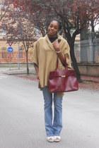 mustard H&M cape - sky blue Levis jeans - brick red Furla bag