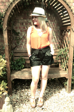 orange top - black shorts