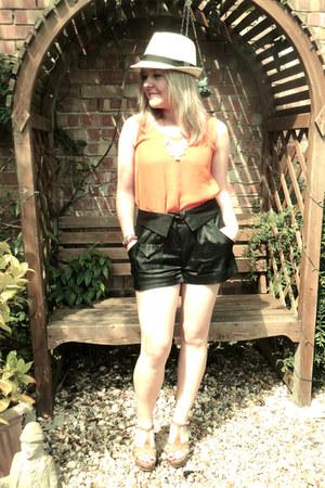 orange top - black shorts