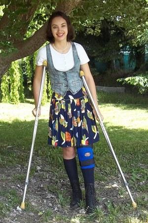 jean vest - short black boots - floral skirt