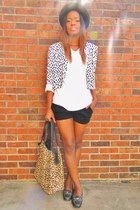 black hat - jacket - bag - black shorts - black gold chain loafers