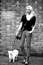 black Christian Louboutin heels - cream Isabel Marant jeans