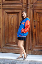 blue varsity H&M jacket - black pleated H&M skirt - tan Topshop flats