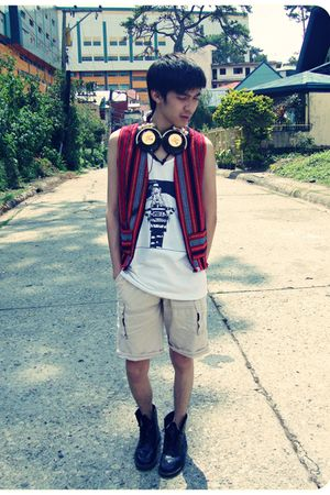 red baguio vest - black Dr Martens shoes - gold Skullcandy accessories