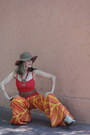Necklace-boho-hat-orangey-red-shirt-sunglasses-wedges-pants
