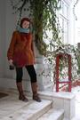 Red-cardigan-green-sweater-black-pants-red-hat-brown-leonardo-boots-re