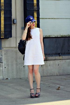 baseball hat - white linen dress - brown backpack bag - floral wedges