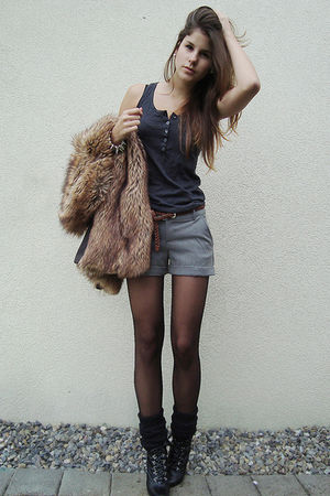 brown vest - black boots - black tights - gray shorts - black socks - green top