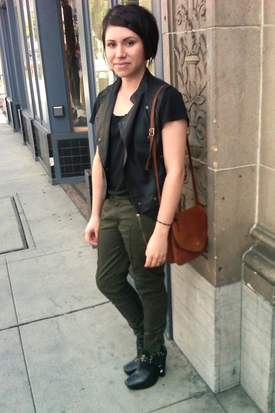 black vest - black top - army green pants - black wedges - tawny bag