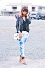 Blue-tie-dyed-jeans-black-faux-leather-jacket